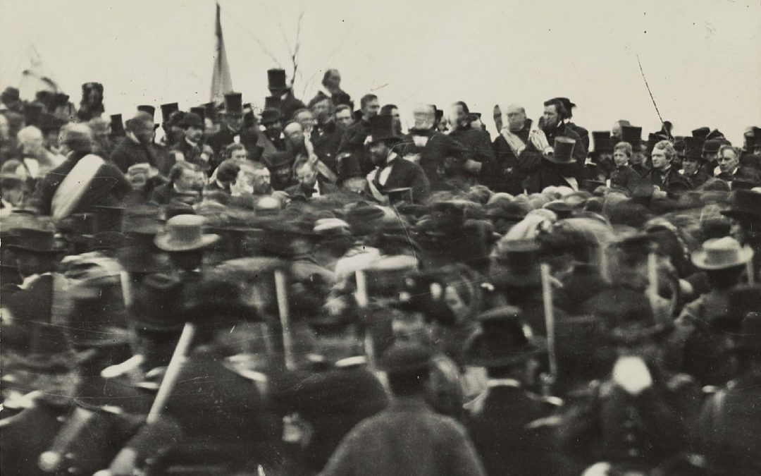 One of the two confirmed photos of Lincoln (center, facing camera) at Gettysburg, taken about noon, just after he arrived and some three hours before his speech. To his right is his bodyguard, Ward Hill Lamon.